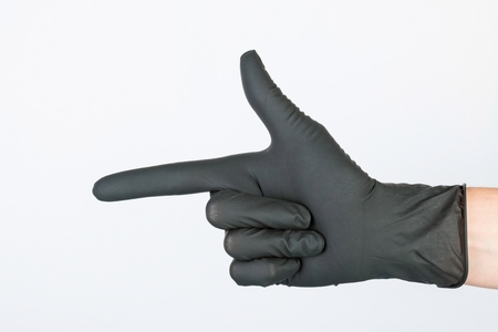 utiles de aseo personal: Hand in black medical glove.
