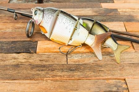 Fishing baits on wooden background. Macro shot. Stock Photo