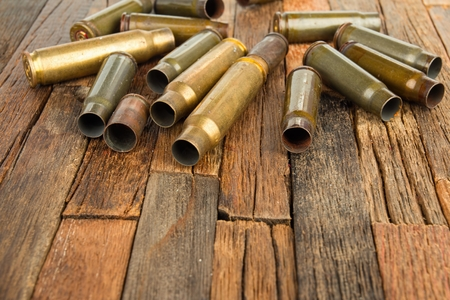 Bullets shell on wooden background. Stock image macro. Stock Photo