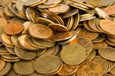 numismatics: Heap of the coins on wooden background. Stock image macro.