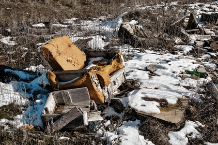 wastes: Old armchair on dump. Garbage and wastes. Stock image.