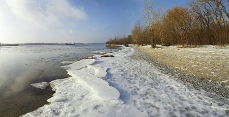 frozen river: Cargo ship in beautiful frozen river. Stock image.