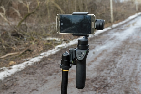 Rostov - on - Don, Russia - January 07, 2017: DJI Osmo mobile gimball device and Samsung Galaxy S6 phone. Editorial
