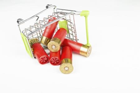 Red hunting cartridges for shotgun in metal shopping trolley. Macro shot. Stock Photo