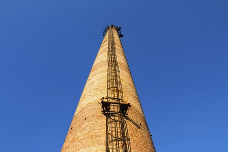 tall chimney: Factory chimney. Old crumbling pipe made of bricks. Steadicam shot.