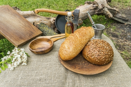 Homemade bread in a wooden bowl on the table. Natural healthy food concept.