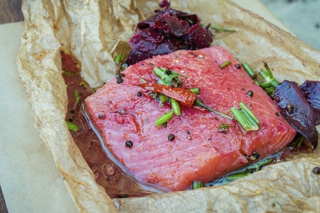 Delicious marinated salmon fillet with beet, pepper, dill and other spices. Diet and healthy food.