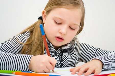Closeup portrait of  girl drawing with colorful pencil Stock Photo - 18791891