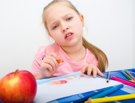 denied: Closeup portrait of girl drawing with colorful pencil Stock Photo