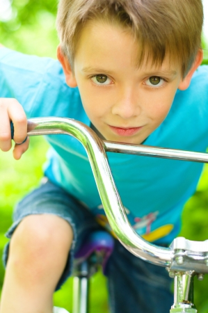 Portrait of a cute boy on bicycle photo