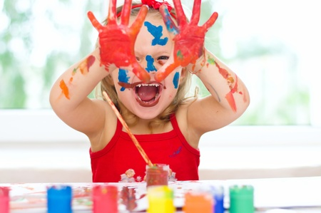 dirty faces: Cute little girl with painted hands
