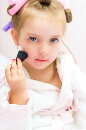 little girl  playing with makeup photo