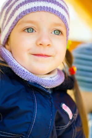 autumn portrait of a cute little girl outdoors photo