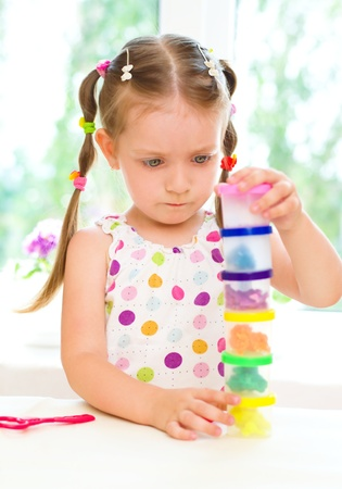 little dough: cute little girl is playing with colorful play dough