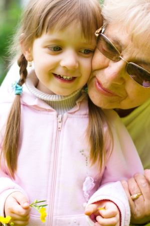 Portrait Of Grandmother With Granddaughter Relaxing Together Фото со стока