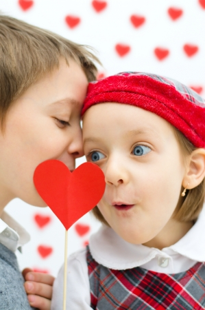 Valentines concept.Couple of kids whispering. photo