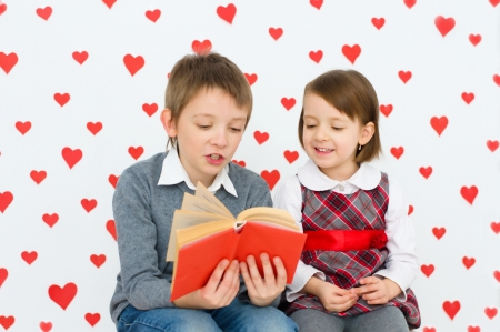 Valentine's concept. Couple of kids reading photo