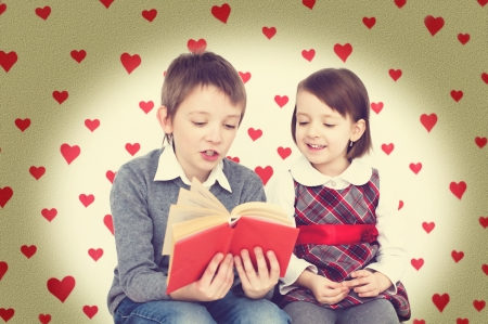 Valentines concept. Couple of kids reading photo