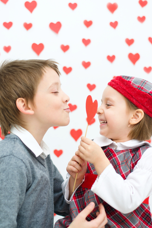 Valentines concept.Couple of kids plays photo