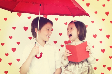 Valentines concept.Couple of kids reading photo