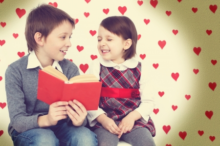 Valentine's concept.Couple of kids reading photo