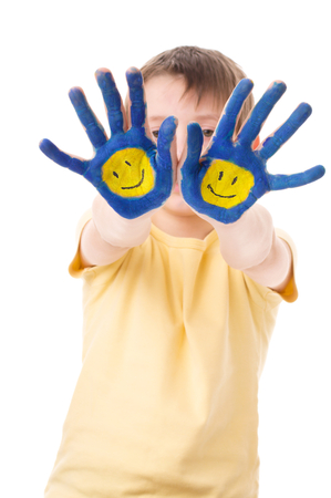 face paint: Portrait of a cute boy showing his hands with painted smiling emoticons, isolated over white Stock Photo