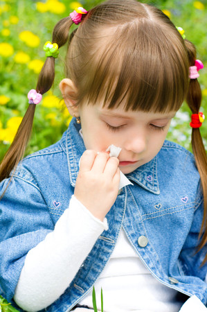 Cute little girl crying outdoors photo