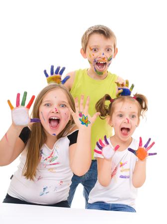Portrait of a couple happy children showing their hands paint