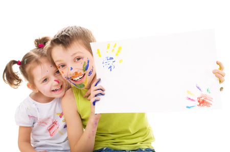 two cute painted kids are holding the blank banner, isolated over white Фото со стока