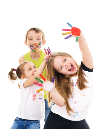 Portrait of a couple happy children showing their hands painted in bright colors, isolated over white photo