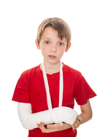 portrait of boy with a broken arm, isolated over white Stock Photo