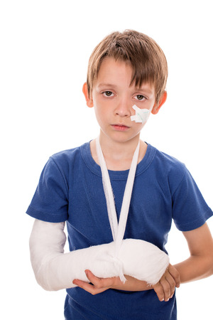 portrait of boy with a broken arm, isolated over white Фото со стока