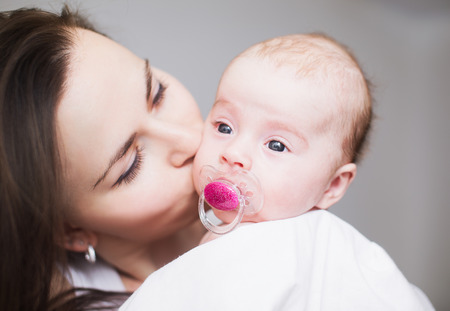 Happy Mother and her Newborn Baby. photo