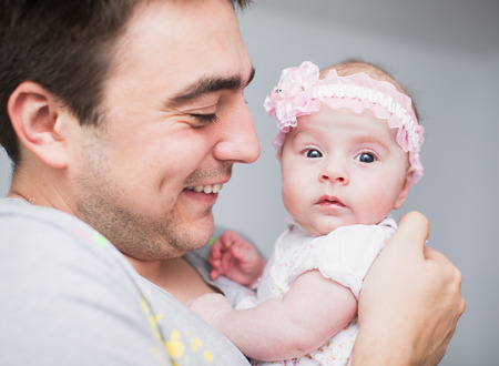 Happy father and his Newborn Baby. Stock Photo
