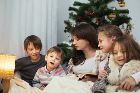 Happy Mother Reading Bible Story to her children