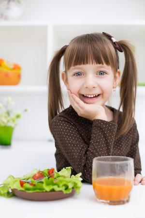 only girls: Little girl eating vegetable salad