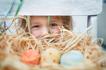 bunny ears: Cute little girl with  colorful easter eggs