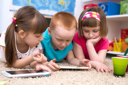 Kids using tablet computer Stock Photo