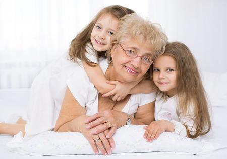 grandmother: Closeup  portrait of happy grandmother with grandchildren