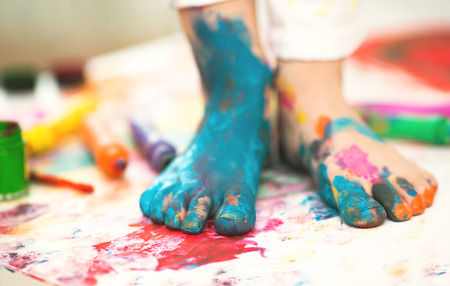 young girl feet: closeup painted in bright colors feet