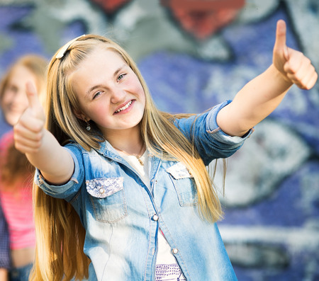 young group: Portrait of happy teens having fun by painted wall Stock Photo