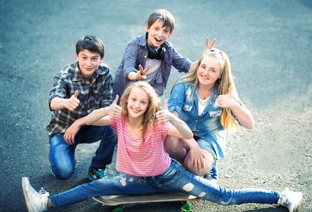Portrait of happy teens having fun outdoors