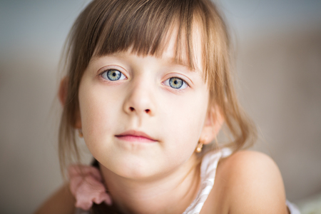 brunette girl: Closeup portrait of a cute Little girl is daydreaming