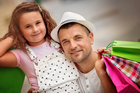 Happy father with daughter have a successful day of shopping Stock Photo