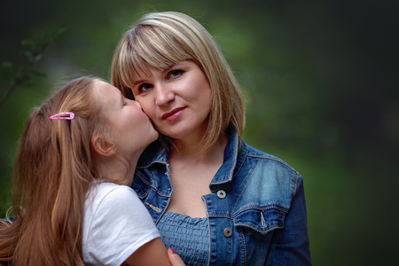 Closeup portrait. Mother with daughter Stock Photo