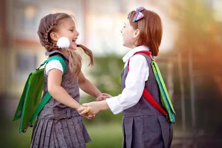 kid book: Happy schoolgirls are going to school