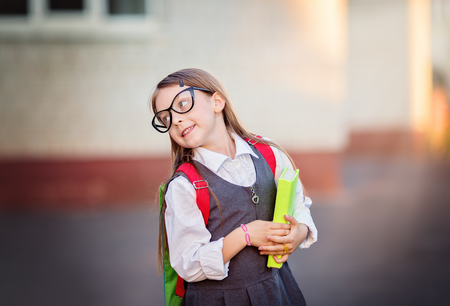Happy schoolgirl is going to school Stock Photo