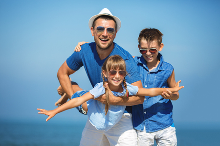 Father with children having fun.  Summer, family, vacation concept photo