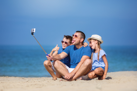 Father with children taking selfie.  Summer, family, vacation concept photo