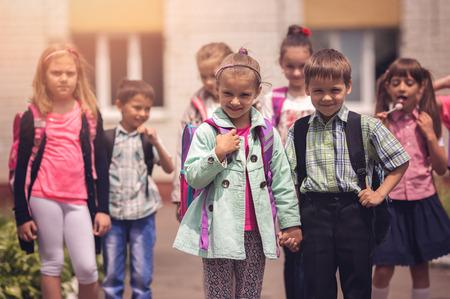 Schoolchildren outdoors Фото со стока